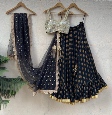 Black ruffle lehenga set with mirror blouse