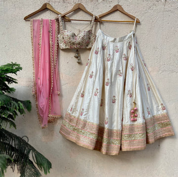 Ivory raw silk lehenga with mirror work and bustier set