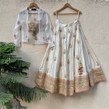 Ivory raw silk lehenga with mirror work and bustier and jacket