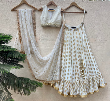 Ivory ruffle lehenga and raw silk blouse set