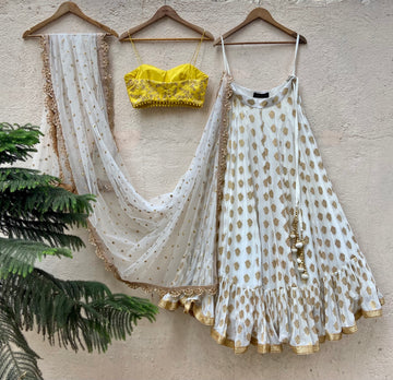 Ivory ruffle lehenga and yellow bustier set