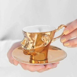DOLL HEAD cup total gold and saucer - Decoriia