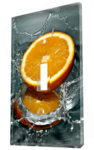 Fresh cut orange falling into water