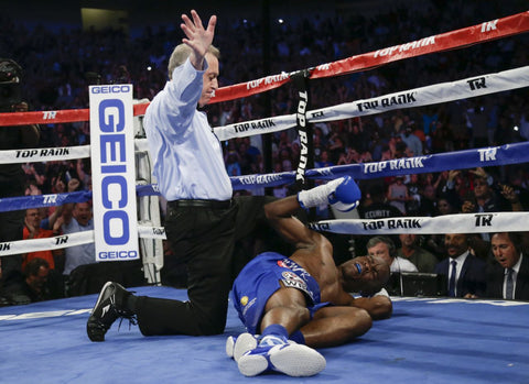 Indongo knocked down by Crawford