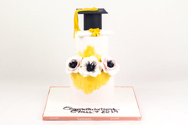 Two Tiered White/Yellow Graduation Cake