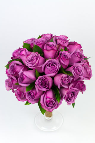 Fresh Purple Roses in a Vase
