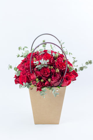 Red Roses in a Flower Bag
