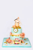 Two Tiered  Pastel Cake with cup on the top