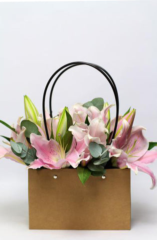Pink Lilies in a  Flower Bag