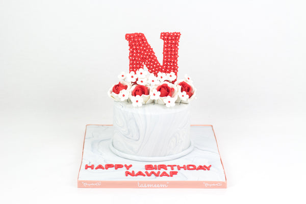 Birthday Cake with Letter on the Top