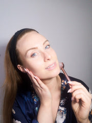 Woman using Crystal Face Roller