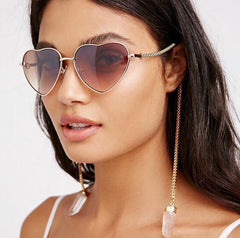 Model wearing MyWillows heart shaped jewellery sunglasses