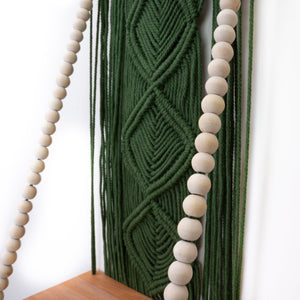 Seaweed green boho style macrame shelf