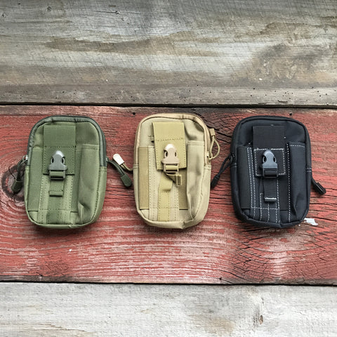 Pictured here are our Molle Utility Pouches in Dark Green Earth, Destert Tan and Black.