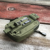 Pictured here is our Dark Earth Green Molle Utility Pouch showing secure survival knife holder.