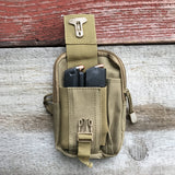 Pictured is our Desert Tan Molle Pouch showing 2 secured 1911 magazines in one of its pockets.