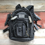 Pictured is our Black Molle Utility Pouch attached to a black Molle Backpack.