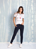 Zoe Karssen Sweatpants HEART PATCH ALL OVER SLIM FIT in Dark Blue Zoe Karssen- Here Now