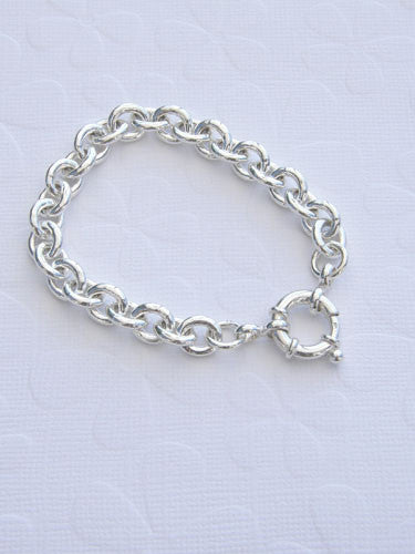 A thick 9 mm slightly oval sterling sliver chain with a large silver clasp. available in 7