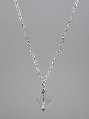 Sterling silver 5 mm round rolo chain with 16 mm crystal ball pendant. Length of chain is 18 inches.