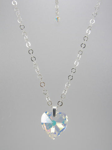Sterling silver chain with 5 mm flat circle links and 28 mm crystal heart pendant.