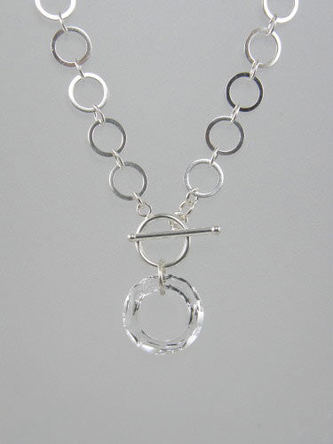Sterling silver chain with 10 mm flat circle links and front toggle with clear round crystal ring pendant.
