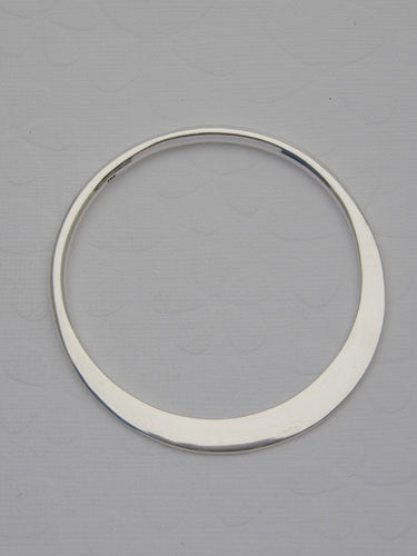 A solid round bangle that can be left plain or can be hand stamped with letters and/or numbers.