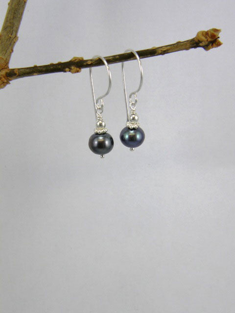 7mm dark grey pearl with silver spacer and ball.