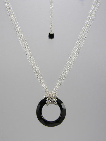 Fine round rolo link sterling silver chain layered and knotted around 30 mm round black crystal ring pendant.
