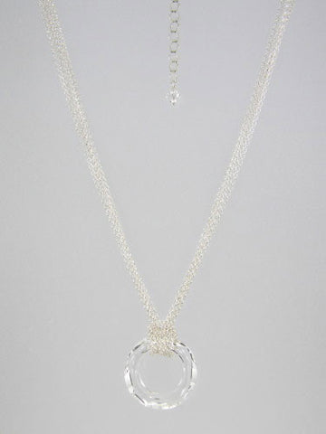 Fine round rolo link sterling silver chain layered and knotted around 30 mm round clear crystal ring pendant.