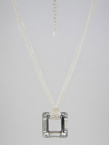 Fine round rolo link sterling silver chain layered and knotted around 30 mm square silver crystal ring pendant.