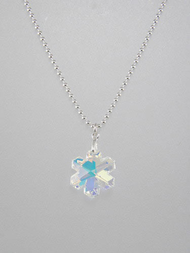 Medium Crystal Snowflake measures 20 mm and is available on sterling silver thick ball or rolo chain or thin leather cord, with sterling silver clasp.