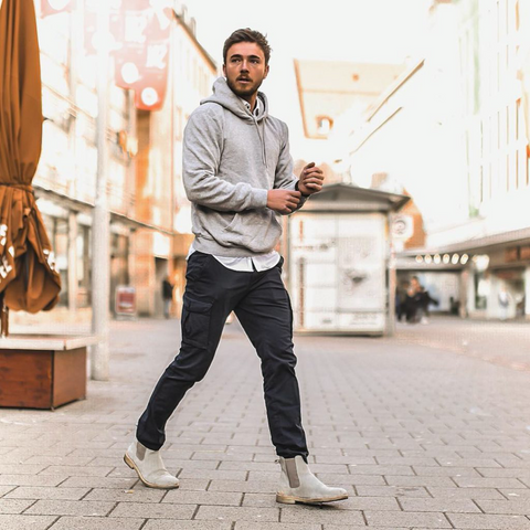 Streetwear outfit with grey hoodie and navy cargo pants