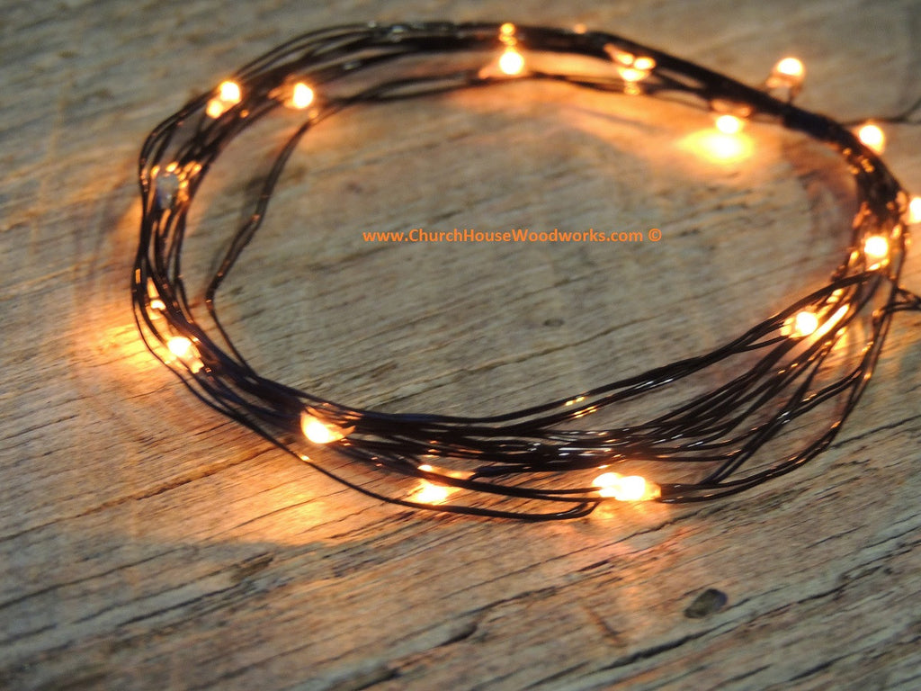 LED Fairy String Lights for rustic weddings wreaths mason jars orange light black wire Fall Halloween lights