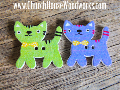 5 Kitty Cat Wood Buttons for crafts, sewing, DIY projects, scrap booking, embellishments and more.   Dimensions: 1 inch wide and 1 inch tall Holes: 2 Material: Wood  Colors: Random Mix