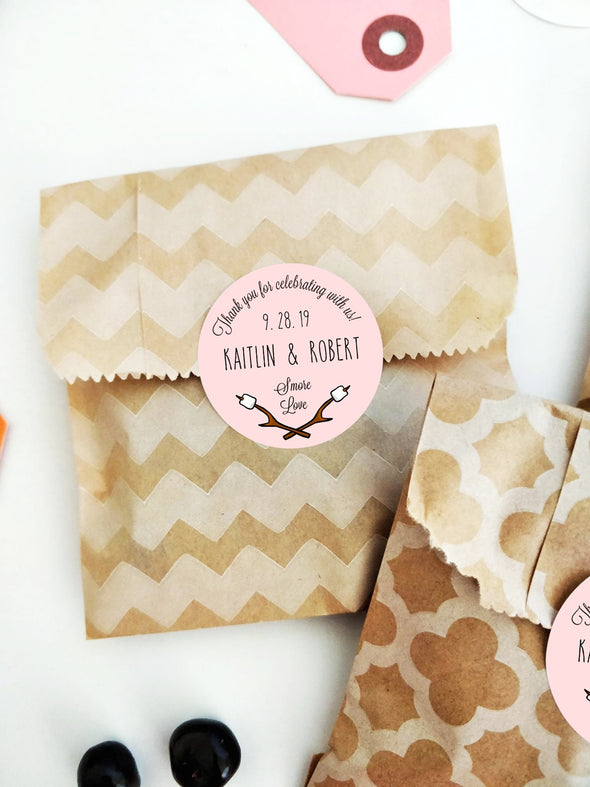 Custom S'mores Favor Labels, shown in pink and styled with favor bags | Once Upon Supplies