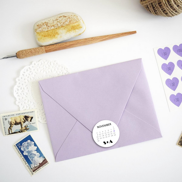 Save the Date Wedding Announcement Envelope Seals Stickers Labels, shown on top of a purple envelope