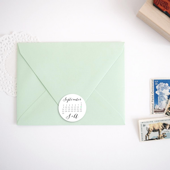 Save the Date Stickers and Labels with Calendar Design, shown on top of mint green envelope