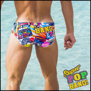 Back view of a sexy male model wearing men's swimwear with pop-culture theme made by the Bang! brand of men's beachwear.