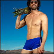 Frontal view of a sexy male model wearing men's swimsuit in royal blue by the Bang! Menswear brand from Miami.