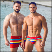 Frontal view of two male models wearing Stripe'A'Pose ROUX men's beachwear by the Bang! Clothes brand of menswear brand from Miami.