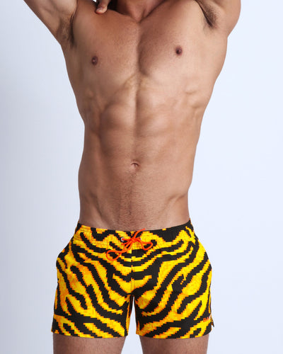 This swimsuit for men features fun and illusion like 8-bit tiger print that will leave you wanting more
