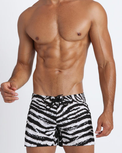 Front view of a sexy male model wearing a BANG Miami flex short with perfect fit designer quality colors and bold prints 2021 summer body gay mens beachwear upgrade