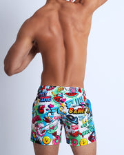 Back view of a sexy male model wearing men's swimwear made by the Bang! official brand of men's beachwear.