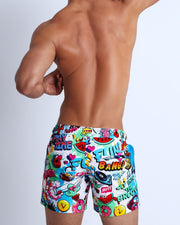 This swimsuit for men features fun and energetic comics-style graphics in bold colors with a prominent BANG! Illustration.