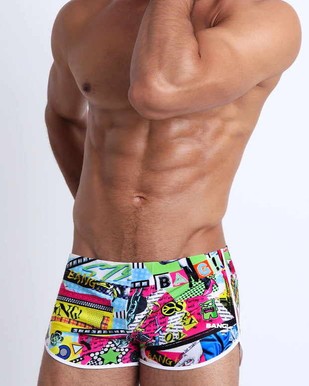 This swimsuit for men features a fun and punk rock-like design with bold colors and a designer quality fit