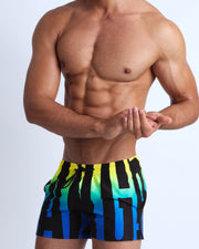 This swimsuit for men features beautiful shades of blue, turqoise, green and yellow in a gradient pattern