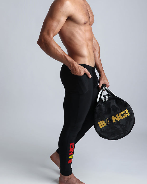 The Weeknder (Black) Bang Clothes Gym Duffel Beach Bag Weekend Travel Bag in black camo with golden logo and details