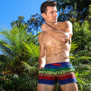 Frontal view of a hot male model wearing premium men's show shorts by the Bang! Clothes company in Miami, Florida. This bathing suit features premium quality fabrics and bold colors