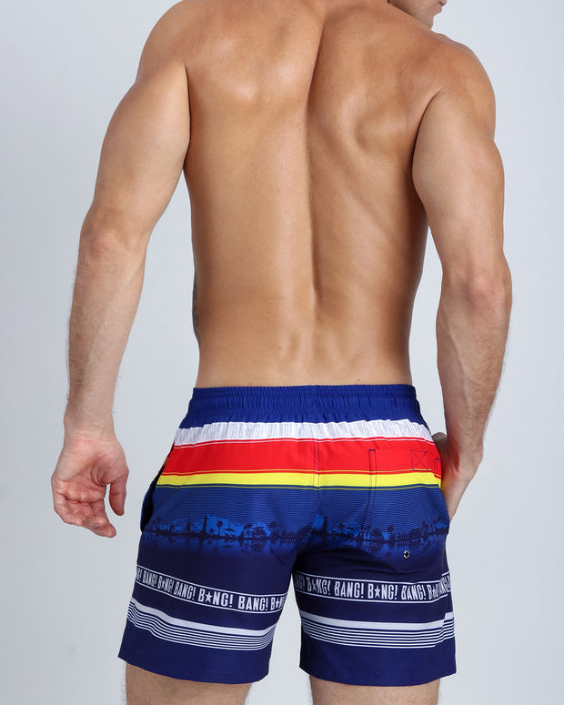 Back side view of a hot male model wearing men's resort shorts by Miami-based Bang! Men&
